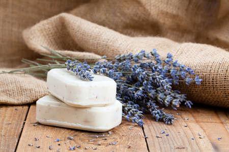 lavender handmade soap bars, on wooden background