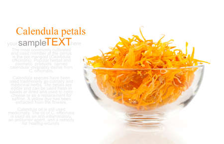 herbal calendula in the glass bowl, isolated white background photo