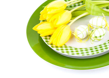 Easter place setting with tulip flower on white background photo