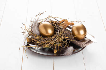 table decoration on white wooden background with Chicken golden egg photo