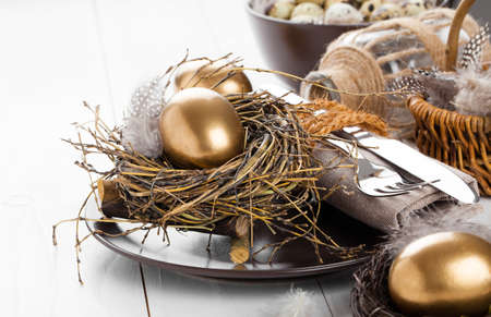 gold egg: table decoration on white wooden background with Chicken golden egg Stock Photo