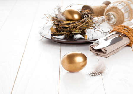 light breakfast: table decoration on white wooden background with Chicken golden egg Stock Photo