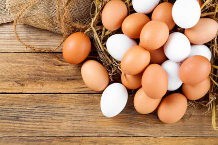 farms: Eggs on wooden background