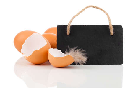 broken egg with blackboard with space for text , on white background photo