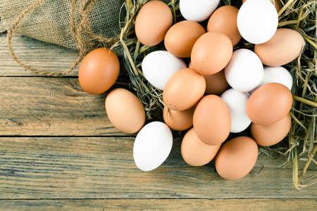 chicken egg: Eggs on wooden background