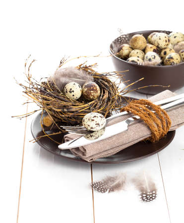 table decoration on white wooden background with quail eggs photo