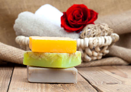 colorful handmade soap bars, on wooden background photo