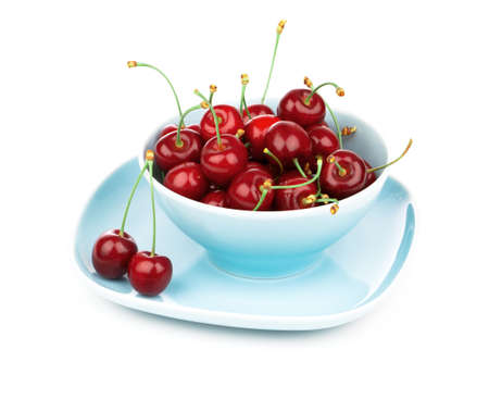 strewed: Bowl full of cherries isolated on white background
