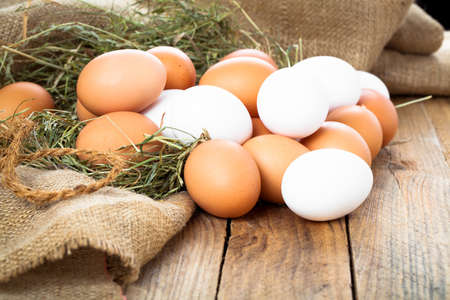Eggs on wooden background