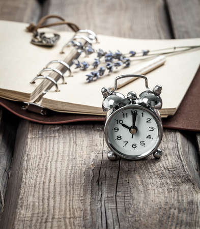 pocket book: Vintage grunge still life with watch, and old book and pencil.