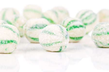 suck: Peppermint olorful candies, on a white background