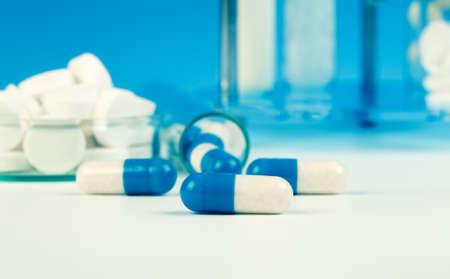 blue medical capsules on white background. photo
