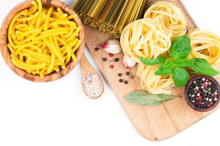 maccheroni: Fresh pasta and italian ingredients, isolated on white background