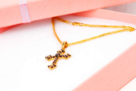 garnets: Golden Cross with garnets in packaged