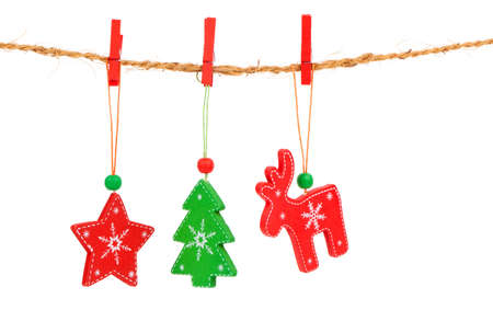 christmas isolated: Christmas decorations hanging isolated on white background