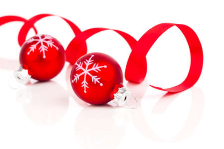 decorating: two red christmas decoration balls with satin ribbon, isolated on white background Stock Photo