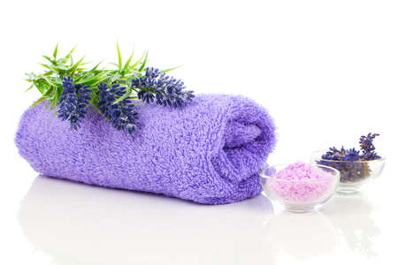 beauty and health: Colorful towel with lavender flower and aromatic bath salt. Isolated on white background