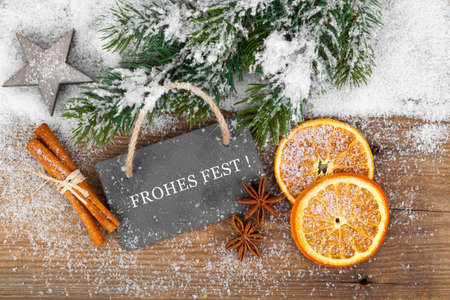 frohe: Christmas decoration with slate board, over wooden background Stock Photo