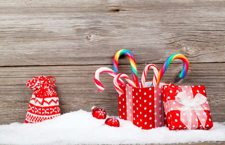 christamas: Christmas decoration with xmas canes, over wooden background Stock Photo