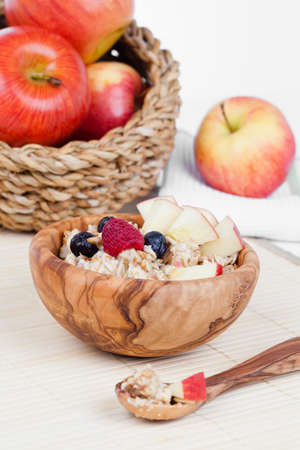 glycemic: Healthy bowl of muesli, apple, fruit and milk for a nutritious breakfast with a low glycemic index ensuring plenty of energy for the day