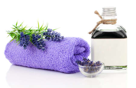 spa therapy: fresh lavender blossoms with Natural handmade lavender oil, on white background