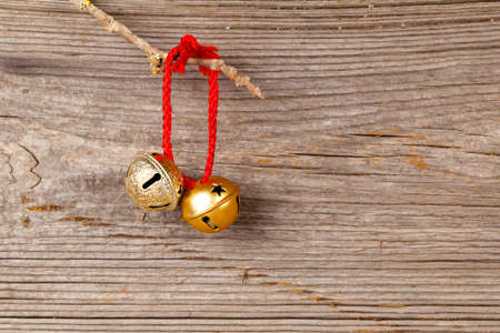 jingling: Christmas bells on wooden background