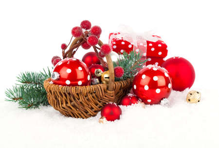 christmas decorations: Christmas balls and fir branches with decorations isolated over white