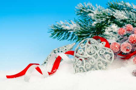 glitzy: Christmas decoration over snow, blue background