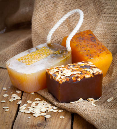 rope: honey handmade soap, on wooden background