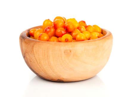 argousier: Fresh sea buckthorn berry in a wooden bowl