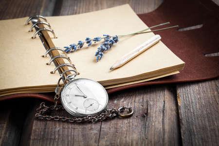 pocket book: Vintage grunge still life with pocket watch, lavender flower and old book.