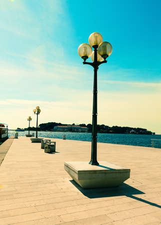 berth with street-lamp on sea background. Pula Croatia