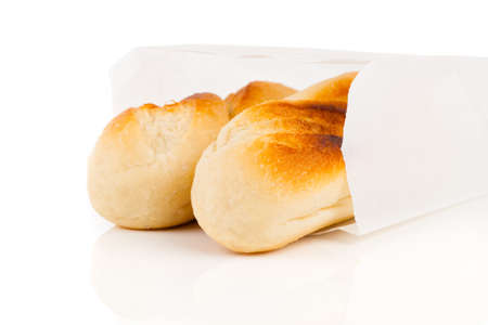 french bread rolls: Baguette in paper bag isolated on white background Stock Photo