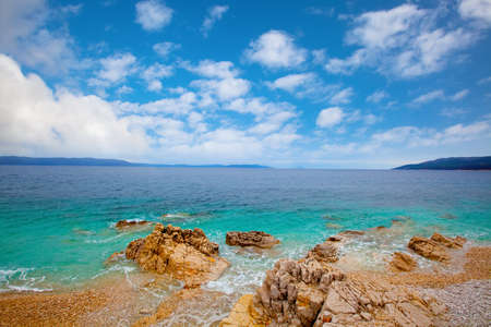 azure: Small Adriatic coastline Croatia. Clear azure water under blue sky. Stock Photo