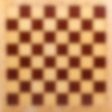 tablero de ajedrez: Resumen borroso tablero de ajedrez de madera de fondo del bokeh