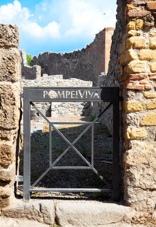 roman pillar: Pompeii, Italy. The ruins of the Roman city of Pompeii. Pompeii, a ruined Roman city near modern Naples in region of Campania, southern Italy. Stock Photo