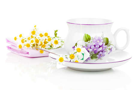 field mint: camomile tea on a white background