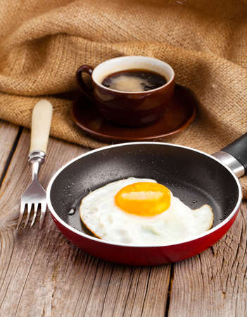 diet dinner: fried eggs on a wooden background