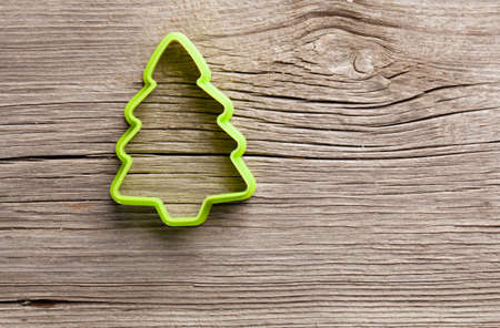 pastry cutter: shaped cookie cutter on a wooden background