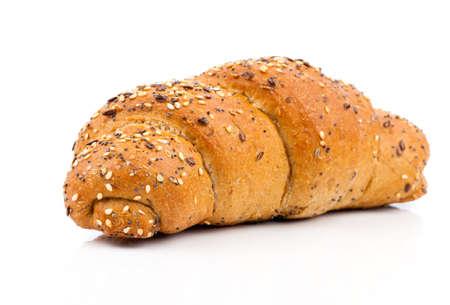 白い背景にゴマの種をまくパン 写真素材