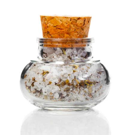 白い背景にコルク瓶にスパイスを入れた塩 写真素材