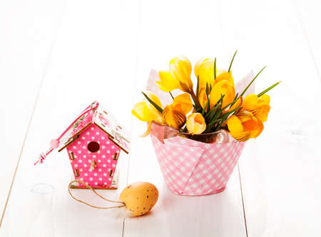 crocus flowers on white wooden background, spring decoration with easter eggs 写真素材