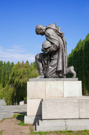 Statue of a russian soldier at the Soviet War Memorial and military cemetery in Berlins Treptower Park