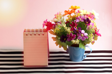 Beautiful pink flowers with a message card paper in a vintage sun light style