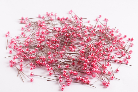 push in pins: Many pink color sewing push pins isolated on white background Stock Photo