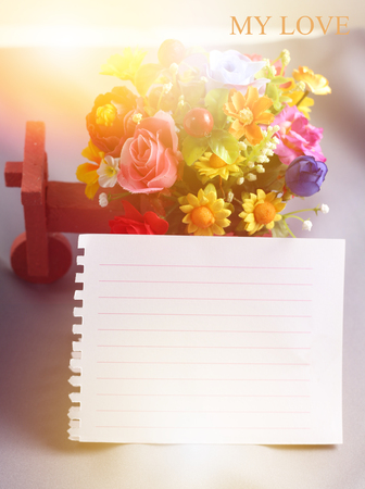 close up decorative rose and notepad paper space for text