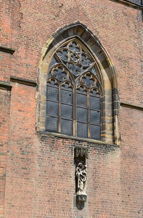 gothic window: The Gothic Church of St. Giles in Nymburk, Czech republic. Detail of South-West facade. Gothic window under the entrance