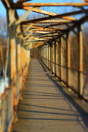 old metal bridge, perspective view, tilt shift