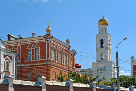 Travel showplace - Iversky Womens Monastery in Samara in sunny summer day, blue sky. Classic russian ortodox religion architecture