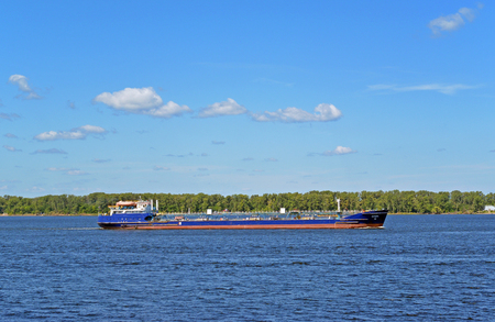 Samara, Russia - august 10, 2017: Volgoneft 256 is an oil tanker of the sea-river class,designed to transport crude oil and petroleum products. Side view on boat on Volga river at summer sunny day